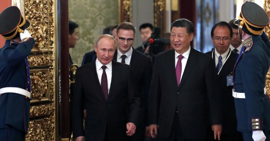 Russian President Vladimir Putin and Chinese President Xi Jinping walk during their meeting at the Kremlin in Moscow, Russia, June 5, 2019, photo by Maxim Shipenkov/Pool/Reuters