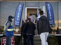 People line up to cast their ballots for the upcoming presidential election as early voting begins in Cincinnati, Ohio, October 6, 2020, photo by Megan Jelinger/Reuters
