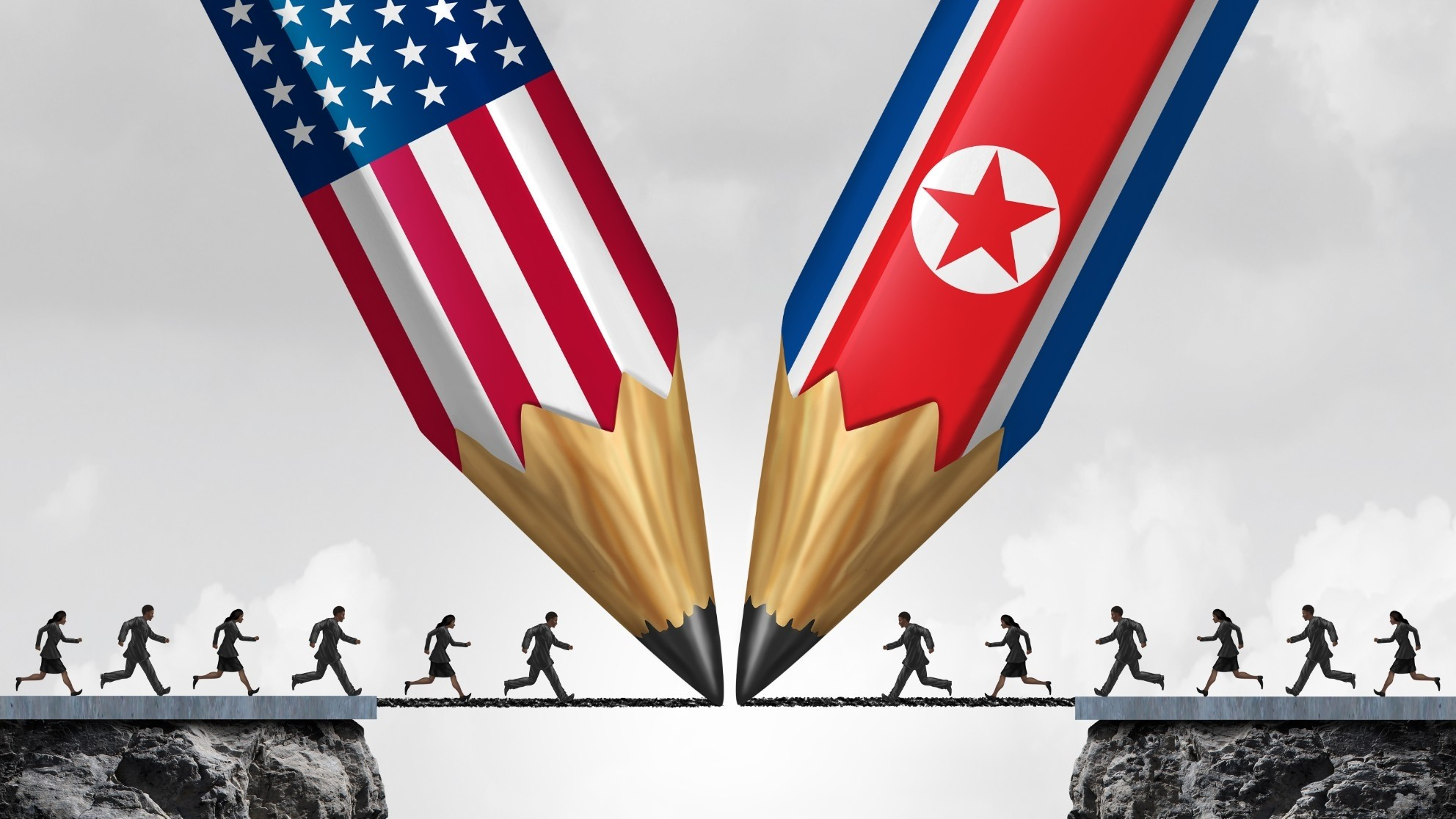 U.S. and North Korean diplomacy depicted by pencils and people running off cliffs to meet in the middle, photo by wildpixel/Getty Images