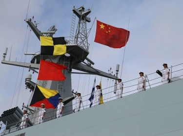 People's Liberation Army soldiers stand on a ship sailing off from a military port in Zhanjiang, Guangdong province, July 11, 2017, photo by China Stringer Network/Reuters