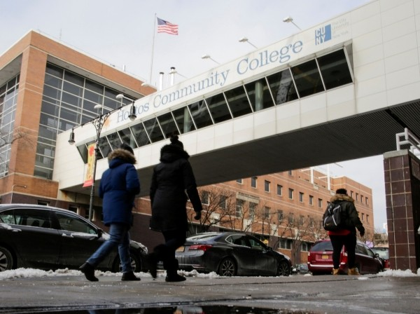 People walk outside Hostos Community College in the Bronx borough of New York, December 16, 2017, photo by Eduardo Munoz/Reuters