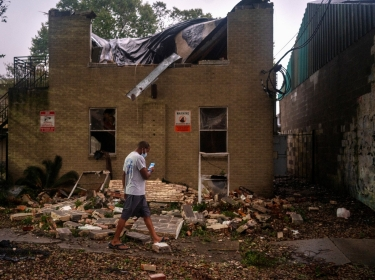 Joel Martinez takes a photo of Washington Gardens Apartments, which collapsed from winds brought by Hurricane Zeta in New Orleans, Louisiana, October 28, 2020, photo by Kathleen Flynn/Reuters
