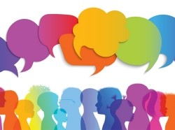 Illustration of silhouettes of a group of chidlren with speech bubbles, all in rainbow colors, photo by melitas/Getty Images