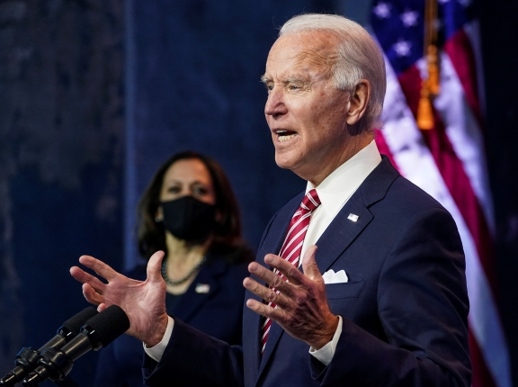 U.S. President-elect Joe Biden speaks about the U.S. economy as Vice President–elect Kamala Harris stands by in Wilmington, Delaware, November 16, 2020, photo by Kevin Lamarque/Reuters