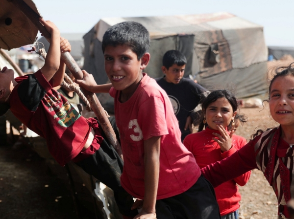 Children play together at Atmeh camp, near the Turkish border, Syria, June 13, 2020, photo by Khalil Ashawi/Reuters