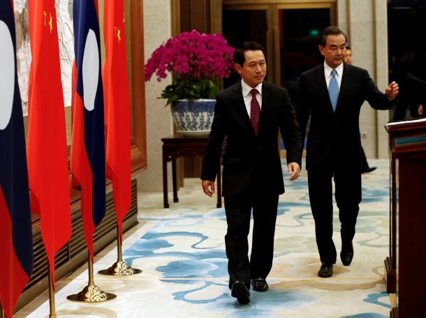 Laos Foreign Minister Saleumxay Kommasith (L) and Chinese counterpart Wang Yi following a meeting in Beijing, China, August 3, 2016, photo by Rolex Dela Pena/Pool/Reuters