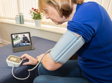 Patient communicates with her doctor via a laptop for advice, photo by Henfaes/Getty Images