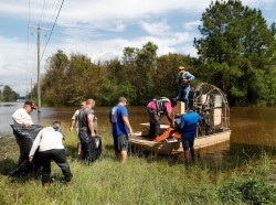 Members of the Cajun Navy transport loggers to clear power lines after Tropical Storm Florence caused massive flooding in Whiteville, North Carolina, September 17, 2018, photo by Randall Hill/Reuters