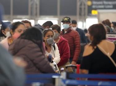 Passengers wait to check in at Tom Bradley international terminal at LAX airport in Los Angeles, California, November 23, 2020, photo by Lucy Nicholson/Reuters