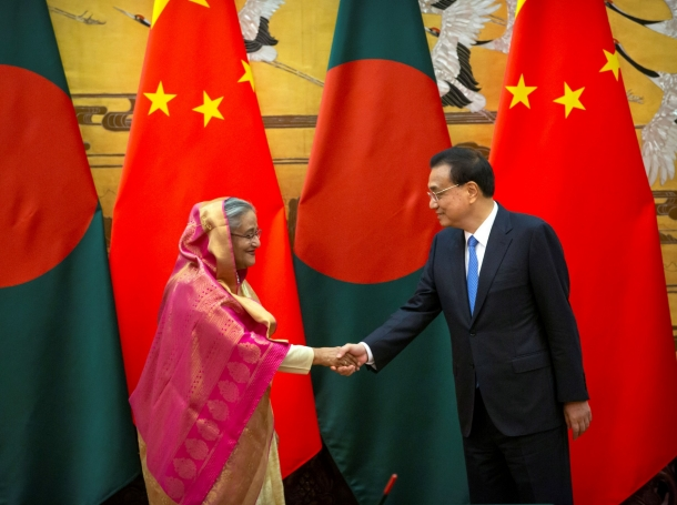 Bangladesh's Prime Minister Sheikh Hasina and China's Premier Li Keqiang shake hands during a signing ceremony at the Great Hall of the People in Beijing, China July 4, 2019, photo by Mark Schiefelbein/Pool via Reuters