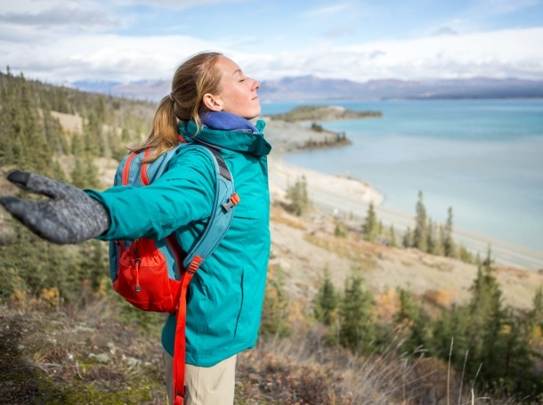 Young woman pausing to take a breath in nature, photo by swissmediavision/Getty Images