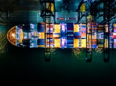 Overhead view of a container ship in port, photo by CHUNYIP WONG/Getty Images