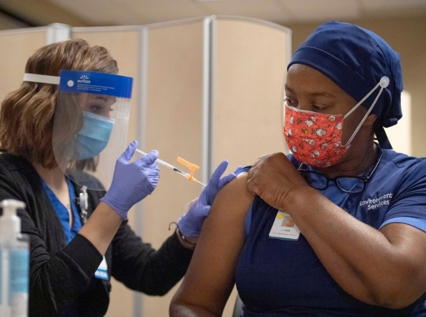 Lynn Jones receives the COVID-19 vaccine at Jackson Madison County General Hospital in Jackson, Tennessee, Friday, Dec. 18, 2020, photo by Stephanie Amador/The Jackson Sun via Imagn Content Services, LLC/Reuters