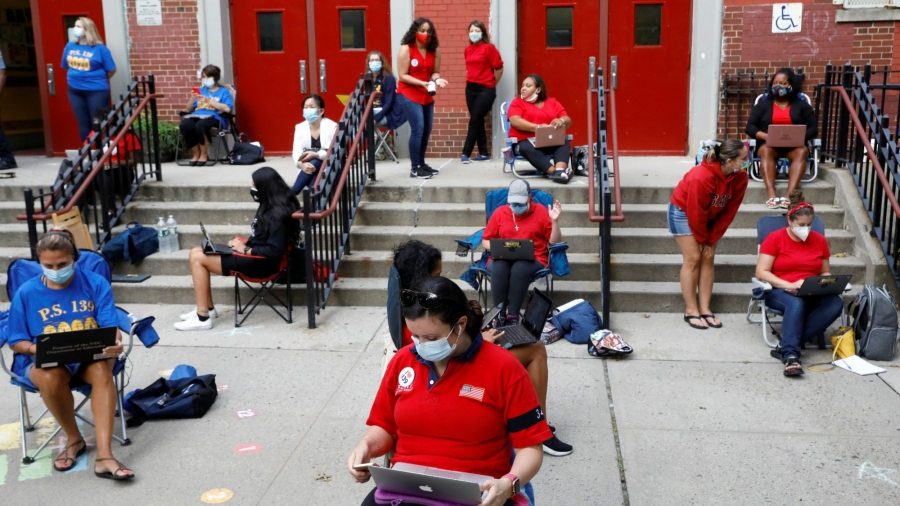 Teachers work outside their school building for safety reasons as they prepare for the delayed start of the school year due to COVID-19, in Brooklyn, New York City, September 14, 2020, photo by Brendan McDermid/Reuters