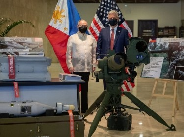 U.S. National Security Advisor Robert O'Brien and Philippines' Secretary of Foreign Affairs Teodoro Locsin Jr. with precision-guided munitions among other defense articles during a turnover ceremony, at the Department of Foreign Affairs in Pasay City, Metro Manila, Philippines, November 23, 2020, photo by Eloisa Lopez/Reuters