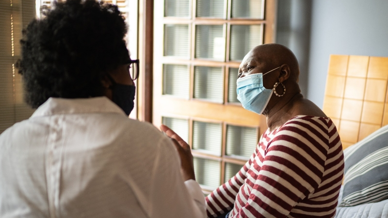 Health visitor and a senior woman during home visit, photo by FG Trade/Getty Images
