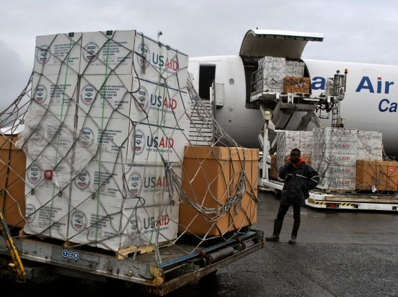 A consignment of USAID medical equipment is offloaded at the Roberts International Airport in Monrovia, August 24, 2014, photo by James Giahyue/Reuters