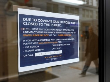 Signage posted on the entrance of the New York State Department of Labor offices in the Brooklyn borough of New York City, March 20, 2020, photo by Andrew Kelly/Reuters