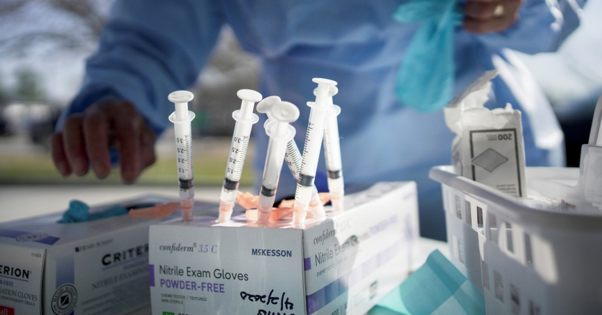 The Moderna COVID-19 vaccine is administered during a drive through event at InclusivCare in Avondale, Louisiana, January 9, 2021 photo by Kathleen Flynn/Reuters
