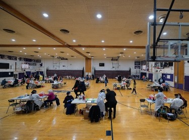 COVID-19 vaccination stations inside Hillcrest High School, a designated New York City priority vaccination center for people in group 1B, in Queens, NY, January 11, 2021, photo by Anthony Behar/Reuters