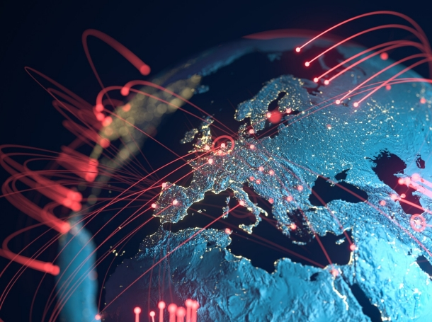 3D rendering of earth with red lines representing communication or weapons, photo by DKosig/Getty Images