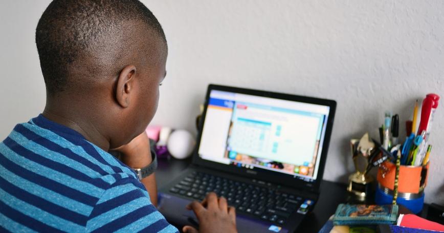 Nine year old student Jordan in his bedroom attending online school in Broward County, Florida, March 31, 2020, photo by Johnny Louis/Reuters