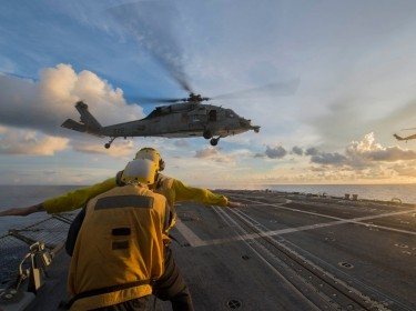 Sailors on the USS McCampbell signal to an MH-60S Sea Hawk helicopter during a training exercise in the South China Sea, July 22, 2016, photo by MC3 Elesia K. Patten/U.S. Navy