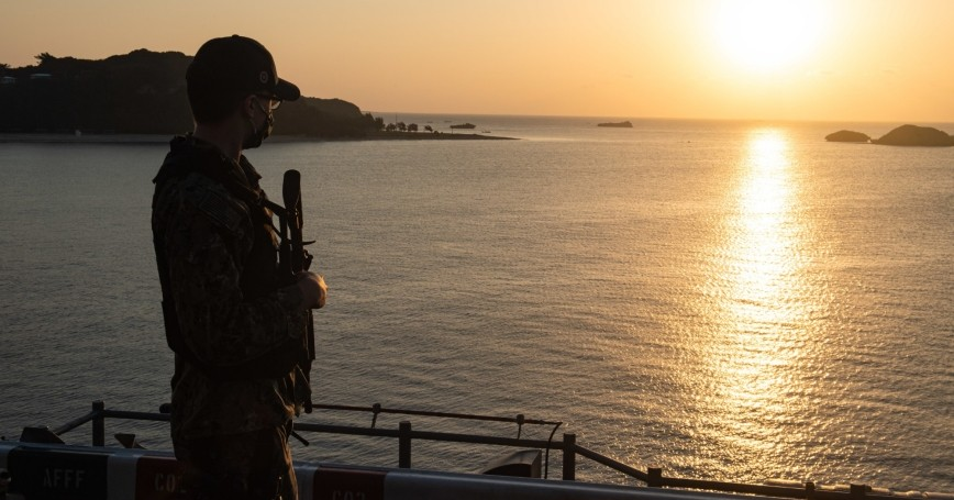 Aviation Electronics Technician Airman Ethan Clabaugh stands watch on the amphibious assault ship USS America in Okinawa, Japan, January 16, 2021, photo by MCSN Matthew Cavenaile/U.S. Navy