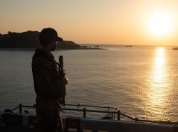 Aviation Electronics Technician Airman Ethan Clabaugh stands watch on the amphibious assault ship USS America in Okinawa, Japan, January 16, 2021, photo by MCSN Matthew Cavenaile/U.S. Navy