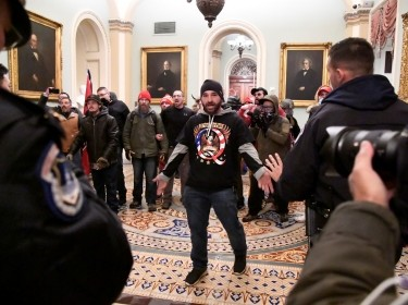 Supporters of President Donald Trump confront police in the U.S. Capitol near the entrance to the Senate, in Washington, DC, January 6, 2021, photo by Mike Theiler/Reuters
