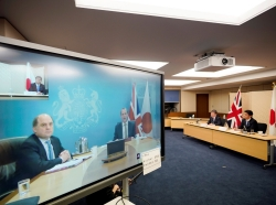 Japan's Defence Minister Nobuo Kishi and Foreign Minister Toshimitsu Motegi attend a video conference with Britain's Foreign Secretary Dominic Raab and Defence Minister Ben Wallace (on the screen) at the Foreign Ministry in Tokyo, Japan, February 3, 2021, hoto by Franck Robichon/Reuters