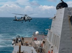 An MH-60R Sea Hawk helicopter takes off from the flight deck of the USS Mustin in the Taiwan Strait, August 18, 2020, photo by Mass Communication Specialist 3rd Class Cody Beam/U.S. Navy