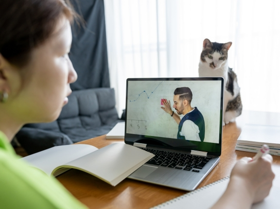 Teenager attending online lesson at home, photo by SetsukoN/Getty Images
