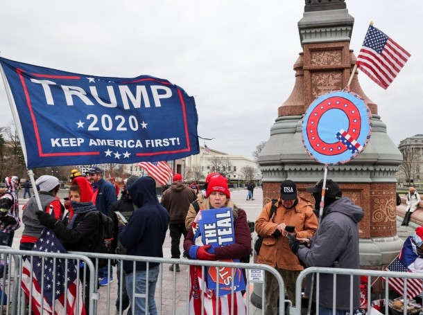 Pro-Trump supporters hold flags as they gather at the U.S. Capitol in Washington, DC, January 6, 2021, photo by Jonathan Ernst/Reuters