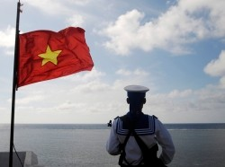 A Vietnamese naval soldier stands guard at Thuyen Chai island in the Spratly archipelago January 17, 2013, photo by Quang Le/Reuters