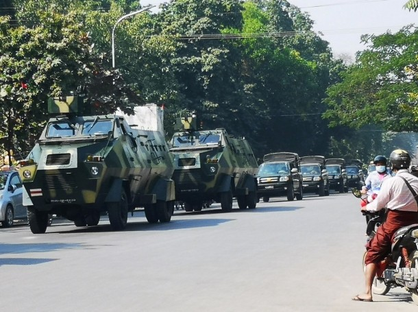 Myanmar Army armored vehicles drive along a street after they seized power in a coup in Mandalay, Myanmar, February 2, 2021, photo by Stringer/Reuters