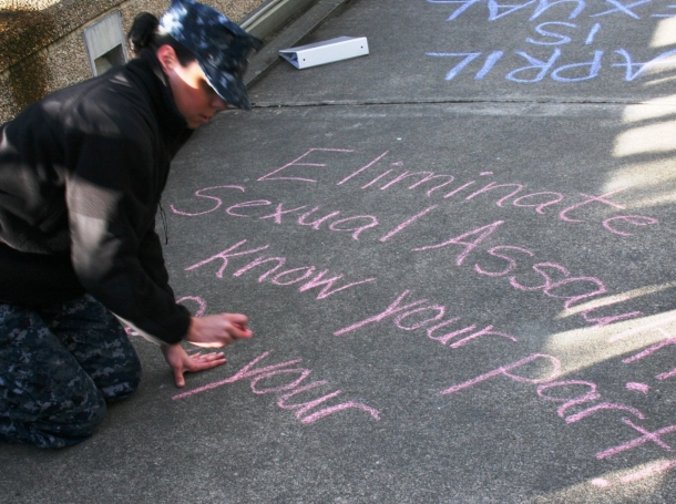 """Lt. Angela Sadosky takes part in a """"Chalk the Walk"""" display for Sexual Assault Awareness and Prevention Month in Bremerton, Washington, April 4, 2016, photo by Douglas H Stutz/U.S. Navy"""