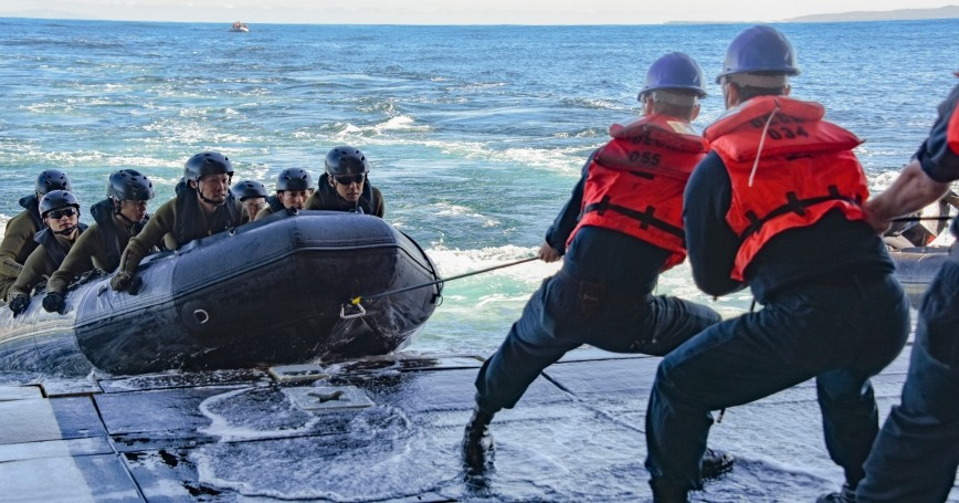 U.S. Navy sailors pull a line affixed to a combat rubber raiding craft with Japan Ground Self-Defense Force Amphibious Rapid Deployment Regiment soldiers in the Pacific Ocean, February 6, 2020, photo by Mass Communication Specialist 2nd Class Natalie M. Byers/U.S. Navy