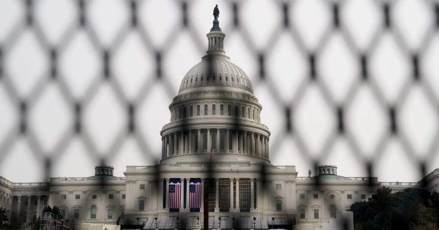 Security fencing surrounds the U.S. Capitol days after supporters of President Donald Trump stormed the building, in Washington, January 11, 2021, photo by Erin Scott/Reuters