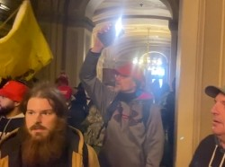 Supporters of U.S. President Donald Trump storm the Capitol building in Washington, DC, January 6, 2021 in this screen grab obtained from a social media video, photo by Brendan Gutenschwager/Reuters