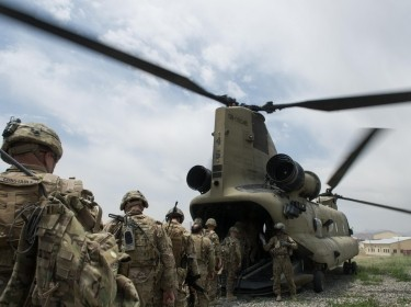 U.S. soldiers and airmen enter an Army CH-47 Chinook helicopter at an Afghan National Army combat outpost in Afghanistan on June 23, 2015, photo by Tech. Sgt. Joseph Swafford/U.S. Air Force