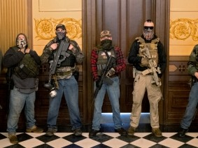 Members of a militia group who were charged in a plot to kidnap Michigan Governor Gretchen Whitmer, in the state capitol building, in Lansing, Michigan, April 30, 2020, photo by Seth Herald/Reuters