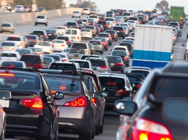 A traffic jam on the 5 freeway heading south in Orange County, California, photo by MCCAIG/Getty Images