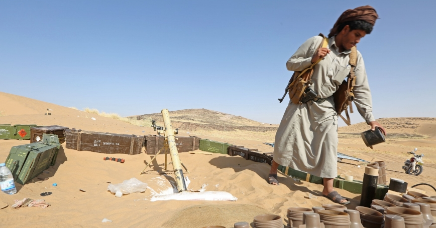 A pro-government tribal fighter stands at his position in Marib, Yemen, October 2, 2020, photo by Ali Owidha/Reuters