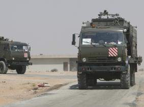 Russian trucks on the road heading to Deir al-Zor in Kabakeb near Deir al-Zor, Syria, September 21, 2017, photo by Omar Sanadiki/Reuters