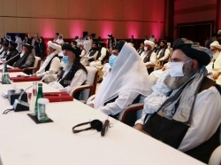 Delegates attend talks between Afghan government and Taliban representatives in Doha, Qatar, September 12, 2020, photo by Ibraheem al Omari/Reuters