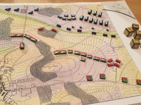 "A reconstruction of the Prussian military wargame Kriegsspiel, based on a ruleset developed by Georg Heinrich Rudolf Johann von Reiswitz in 1824, <a href=""https://commons.wikimedia.org/wiki/File:Kriegsspiel_1824.jpg"">photo</a> by <a href=""https://twitter.com/mkirschenbaum/status/815032700209860609"">Matthew Kirschenbaum</a> / <a href=""https://creativecommons.org/licenses/by-sa/4.0/deed.en"">CC BY 4.0</a>"