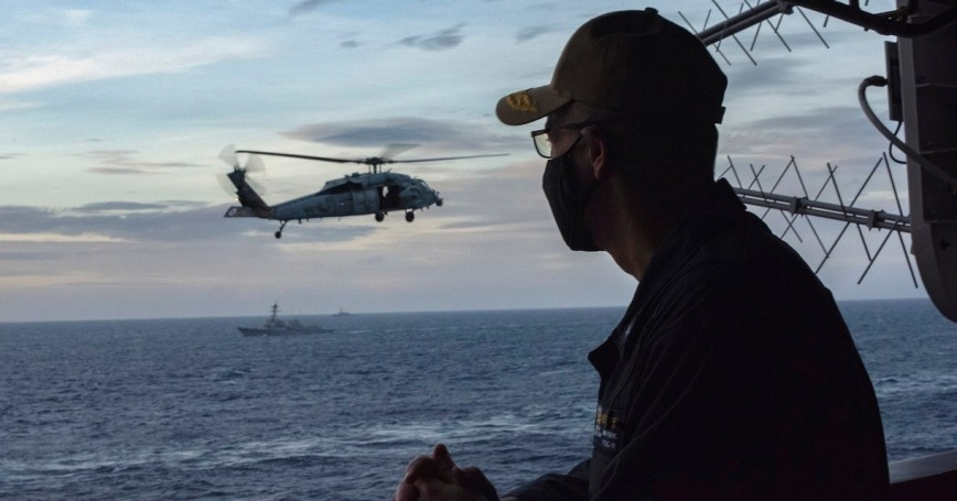 Rear Adm. Jim Kirk, commander of the Nimitz Carrier Strike Group, observes ship formation from the USS Nimitz in the South China Sea, February 9, 2021, photo by Petty Officer 2nd Class Katarzyna Kobiljak/U.S. Navy