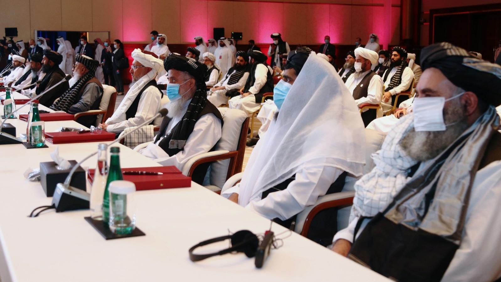 Delegates attend talks between Afghan government and Taliban representatives in Doha, Qatar, September 12, 2020, photo by Ibraheem al Omari/Reuters