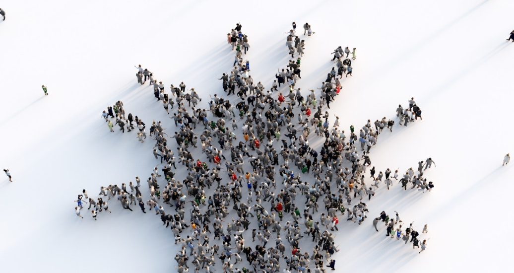 Large group of people making a virus shape, photo by NiseriN/Getty Images